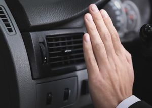 Car Driver Checking Air Conditioning System