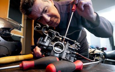Audi Mechanic Repairing Carburetor