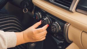 Lady Turning On Car AC